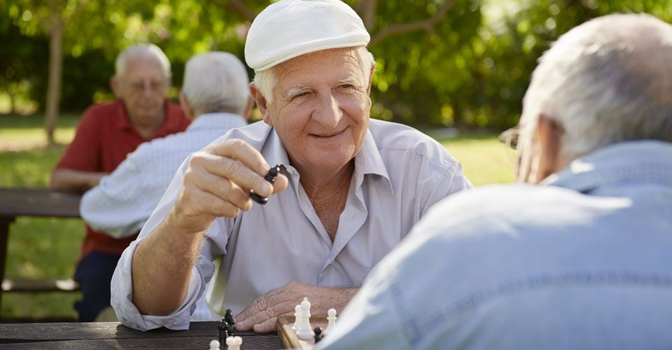 Elderly men play chess